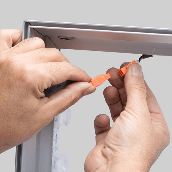 CONNECTING WIRES ON A DOUBLE SIDED LED FABRIC LIGHT BOX
